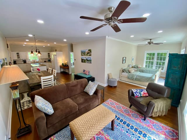 """L-Shaped Great Room, 40' Wide, Showing Kitchen, Dining Area, TV Area & """"Second Bedroom"""".  Unseen is the Middle Bath, & 17'x20' Master Bedroom!  1200 Sq. Ft.!  All Furniture is NEW!"""