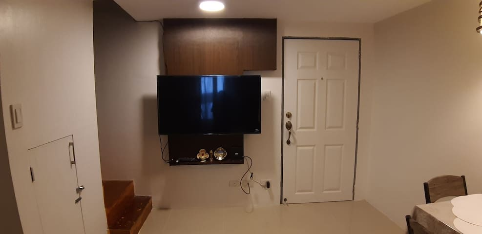 Living area with 49 inch Smart TV