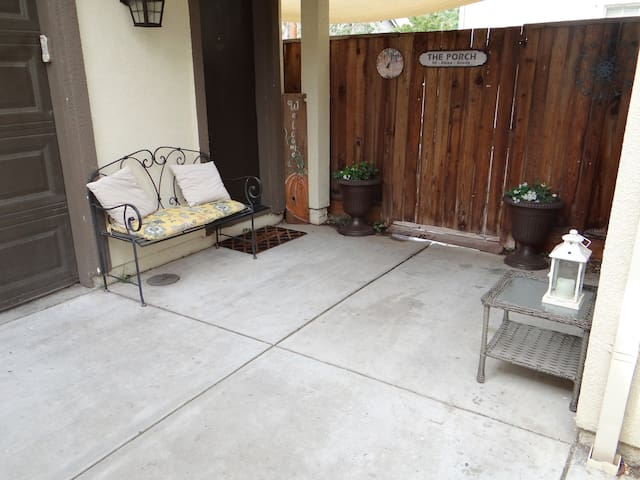Small courtyard with seating area under breezeway.