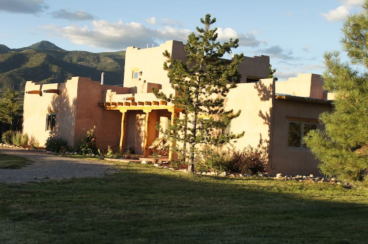 View of the house with the mountains in the background