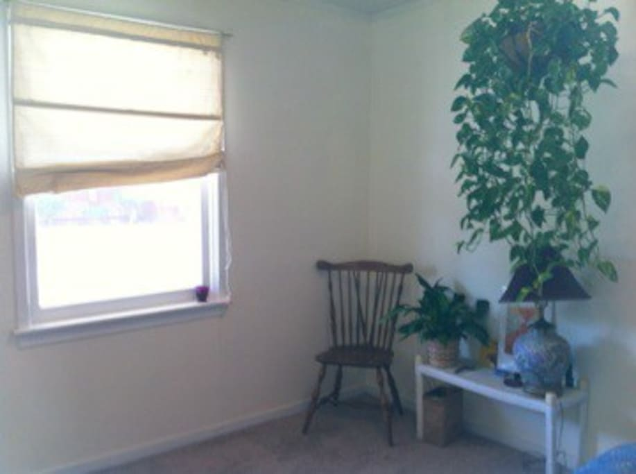 Guest Bedroom Sitting Area; View of Community Garden and San Luis Mountain