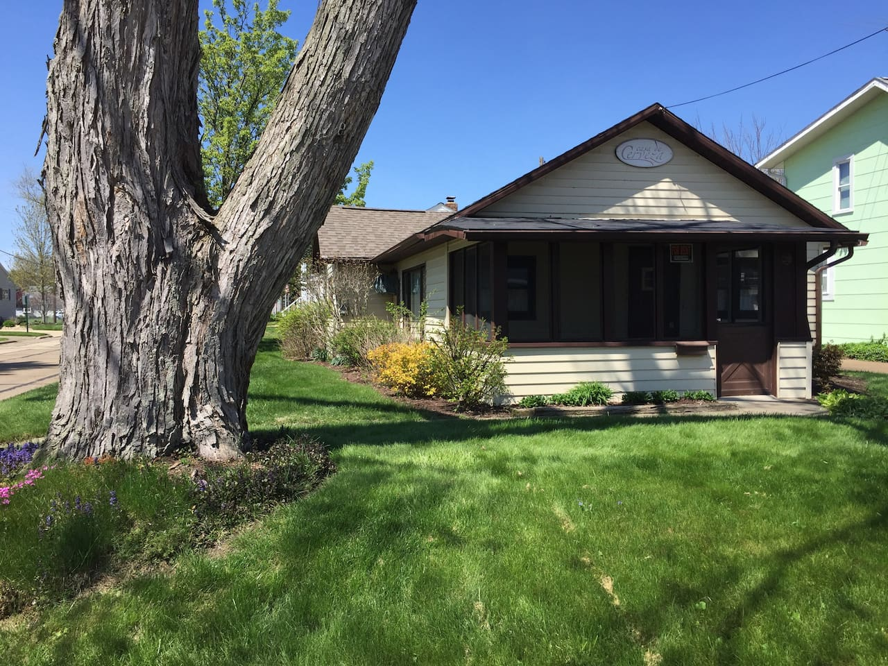 This cozy cottage is situated on a corner lot with an unattached garage in the back.