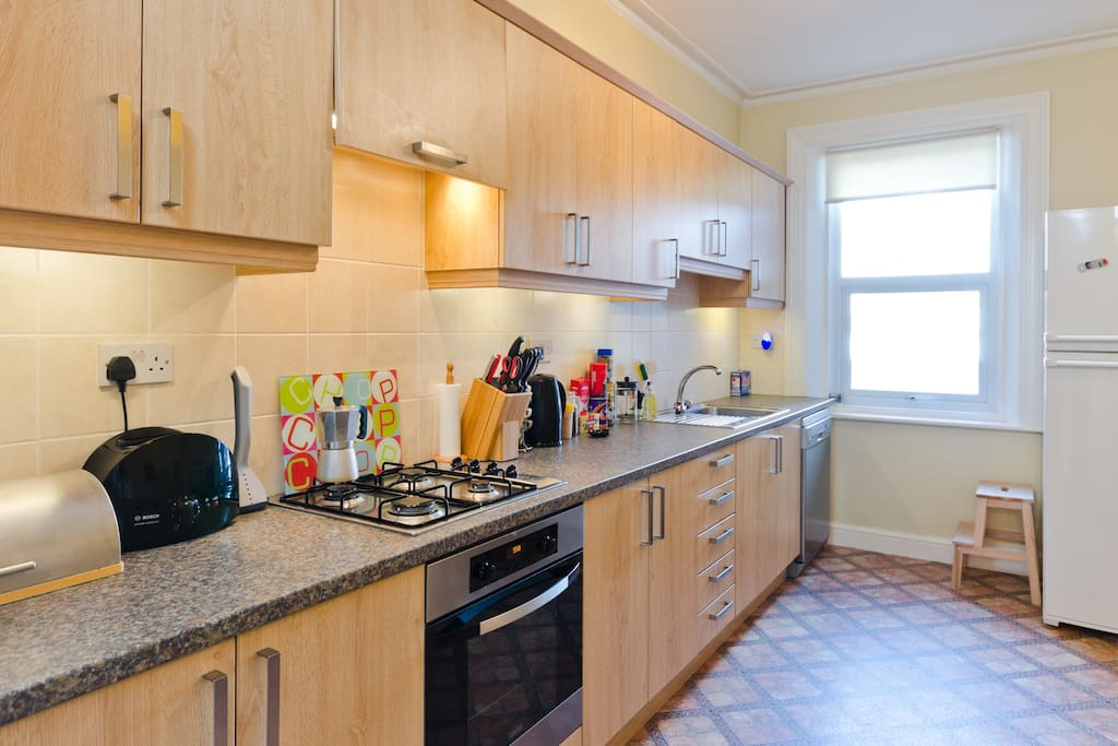 Modern family kitchen with dining space for 7. Plenty of utensils and appliances for all your cooking needs.