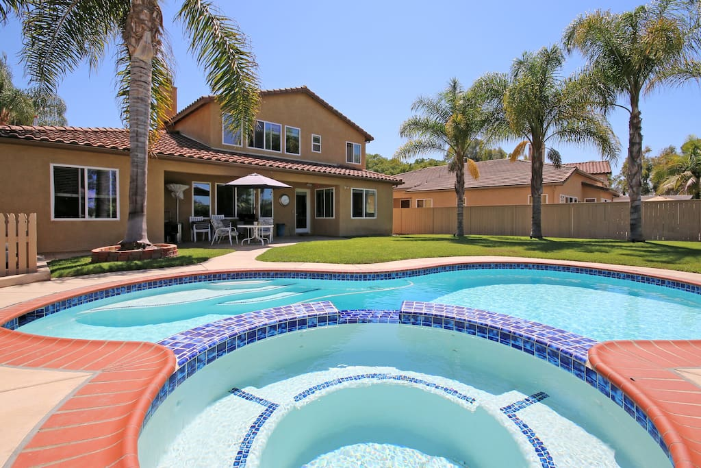 Large backyard with pool, spa & barbeque