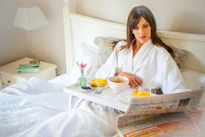 Why get up? Pamper yourself with breakfast in bed, reading the newspaper.