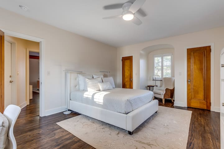 Bedroom has a queen-size bed and lots of room to rest or work.