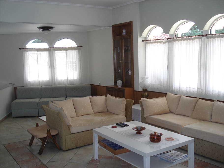 The sitting room (a part of it with 3 sofas)