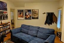 living room other side. Left door goes into a bedroom.