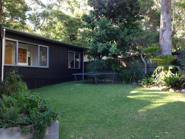 Family friendly backyard with herb garden.