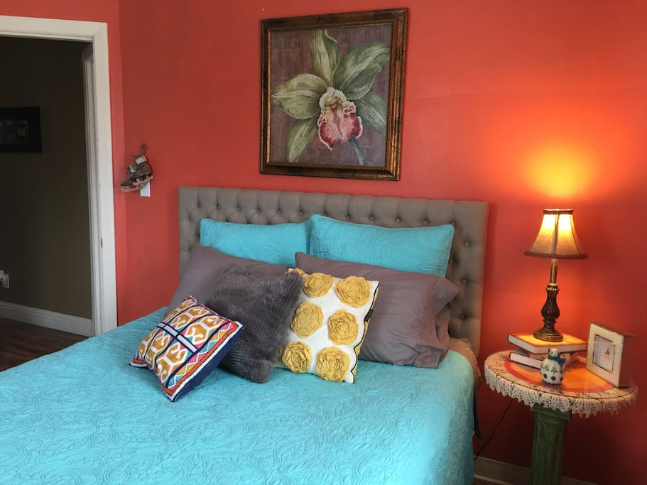A queen size bed waits for you in the back bedroom with a walk-in closet...delightful pillows, soft sheets ...peace and quiet....