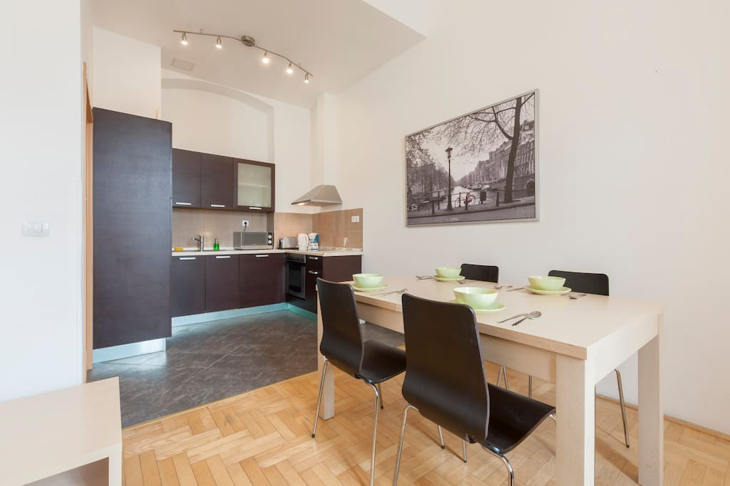 The dining table, to the left is the American kitchen