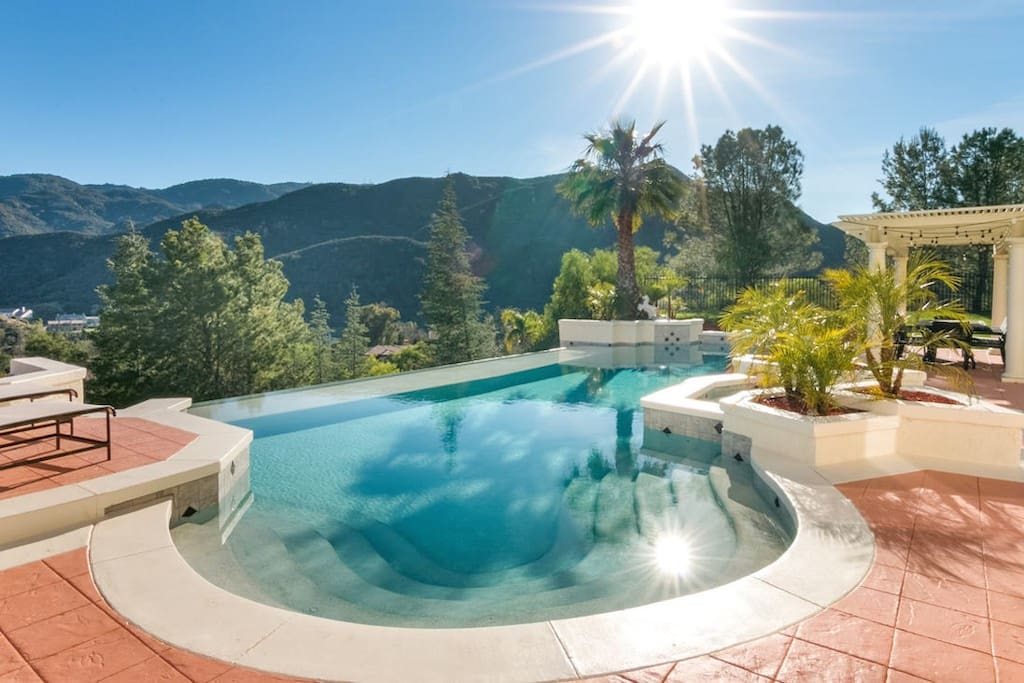 This hillside estate offers breathtaking panoramic valley and mountain views from the private pool.