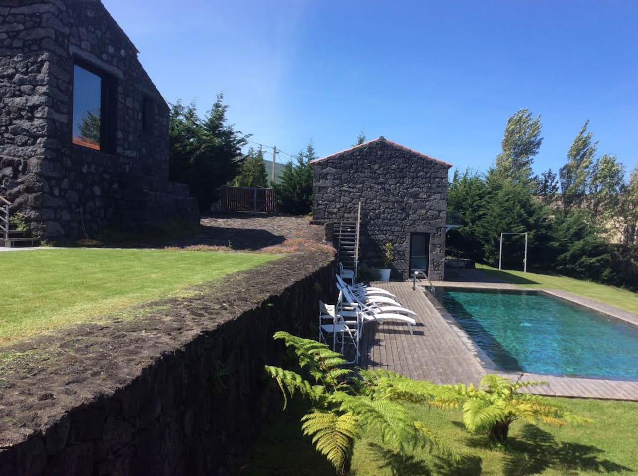 View of main lava house with heated pool and a reconverted barn with an upper storey bedroom and en suite bathroom, plus downstairs room which accommodates 4 people.