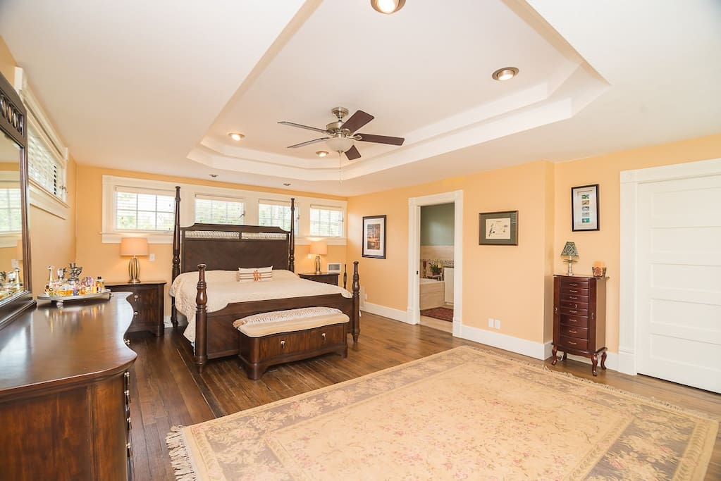 Spacious upstairs master bedroom suite with king bed, Keetsa Pillow Plus mattress, reading nook, and walk-in closet