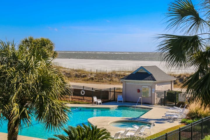See, Feel & Hear the Ocean from this Light-Filled Condo w/ Community Pool & Private Screened Porch.