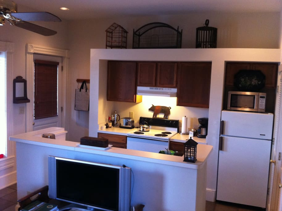 View of the kitchen from the living room.  Cable television in living room