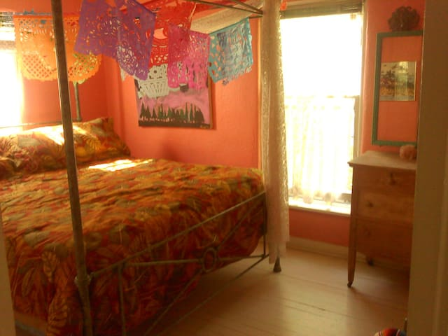 Guest room-papel picado canopy king bed.