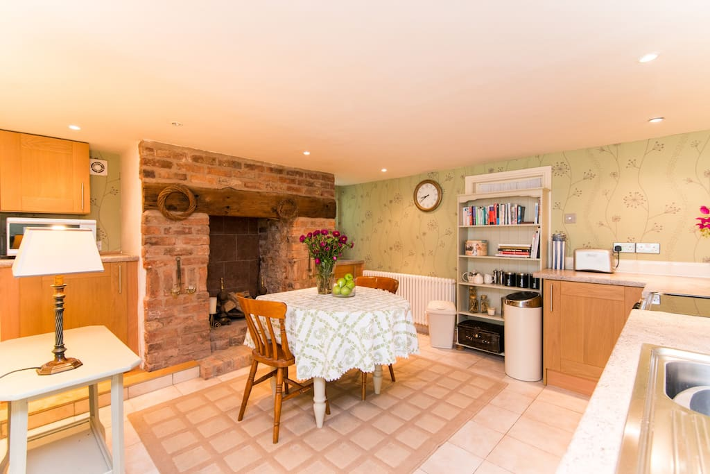 View of the kitchen and brick fireplace