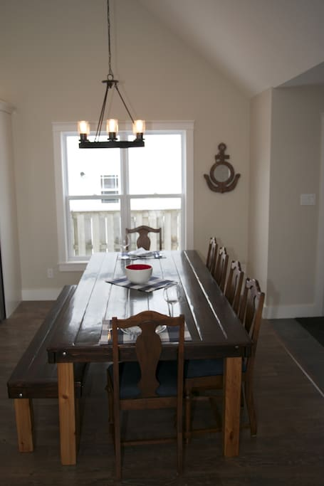 Kitchen table seats 10. Great for big dinners or games night.