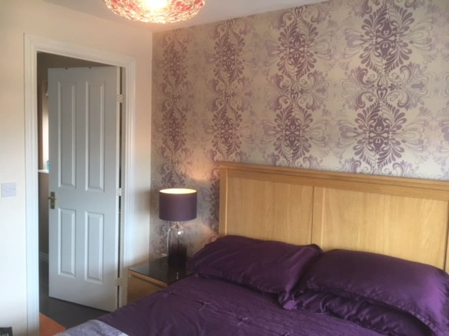 This is the guest room with double bed, 32 inch TV and access to the shower room W.C. through the door in the picture.