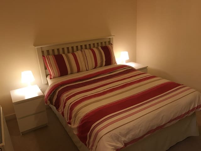 Double bedroom with plenty of additional floor space e.g. to accommodate a travel cot. Both bedside sockets have USB ports for charging mobile devices.