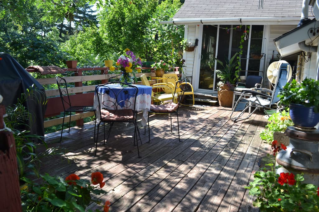Nice large 2nd floor deck for dining and relaxing. Shade and sun, flowers and foliage, with seating and a dinette set for 4.