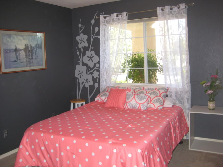 Queen size bed with mattress topper