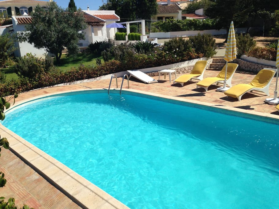 Large private swimming pool with 4 recliners and 2 umbrellas