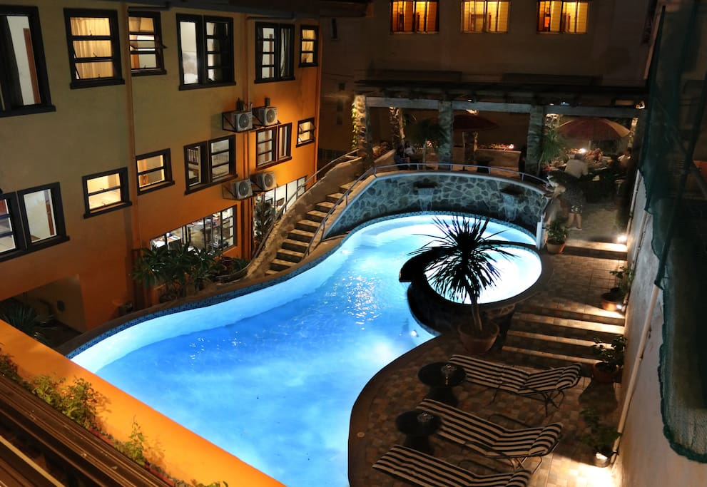 Enjoy the spectacular Glow in the Dark Swimming Pool of 1775 Adriatico Suites! (Check the photos for a virtual tour!)