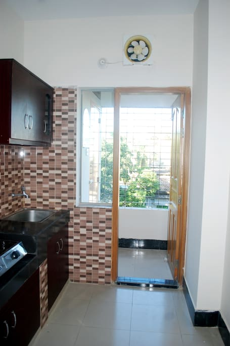 Balcony attached to the kitchen with wash area and store room.