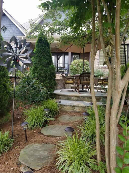 This thoughtfully landscaped back yard is a great place to unwind after the tournament.