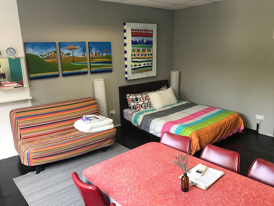 A comfortable Queen Size, a queen sized Sofa Bed (in the rainbow cover) and a super single Sofa Bed (in grey and red trims) offers a comfortable night's rest for up to 5 adults