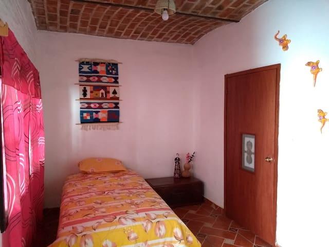Single bed room, half bathroom, no tv