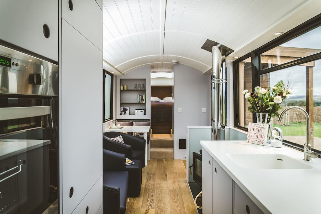 Blue Bus kitchen/lounge with log stove