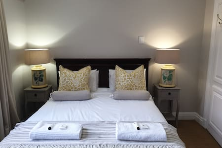 Room 1 has a queen size bed sleeping 2 only with airconditioner  and TV. Shower ensuite.All rooms for guests are upstairs