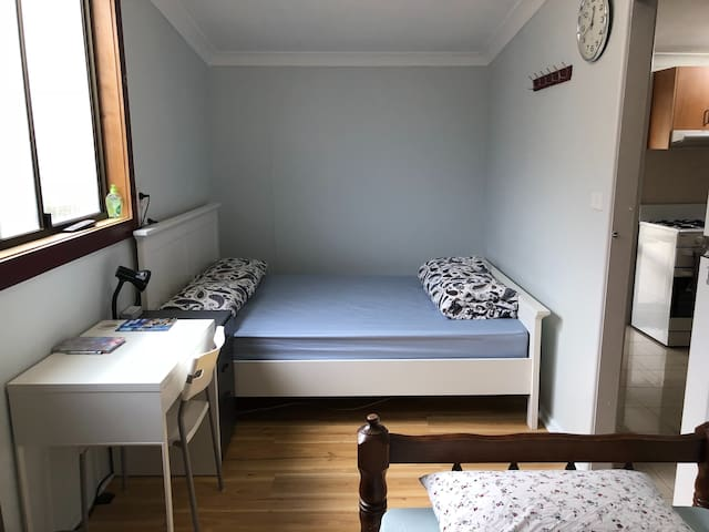 Bright sunny room with aircon and garden access