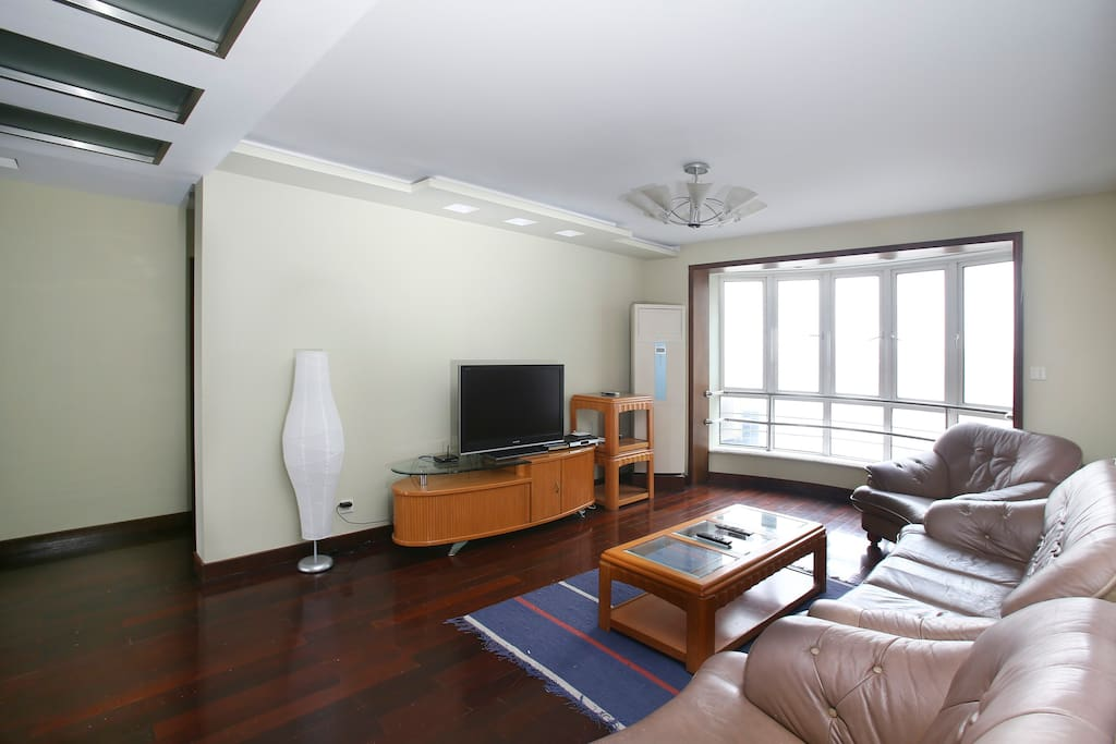 Spacious shared living room with LED TV