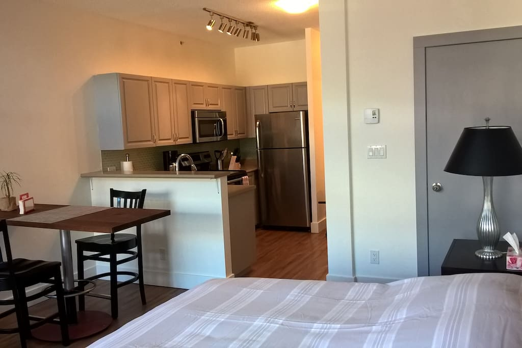 Double Bed, dinner table and fully equipped kitchen