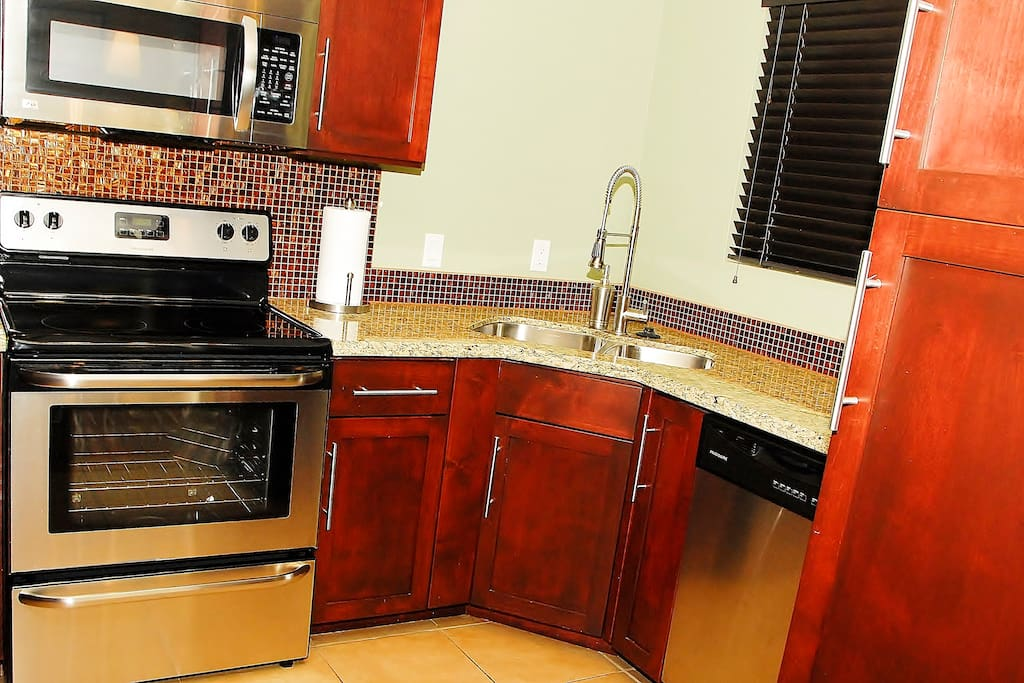 Kitchen with custom cabinets, granite countertops, and stainless steel appliances
