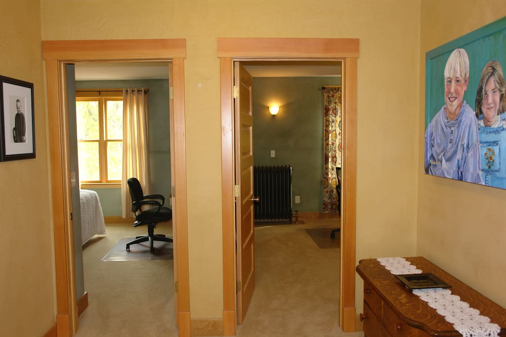 Hallway at top of front stairs with two rooms available to travelers. East facing windows.