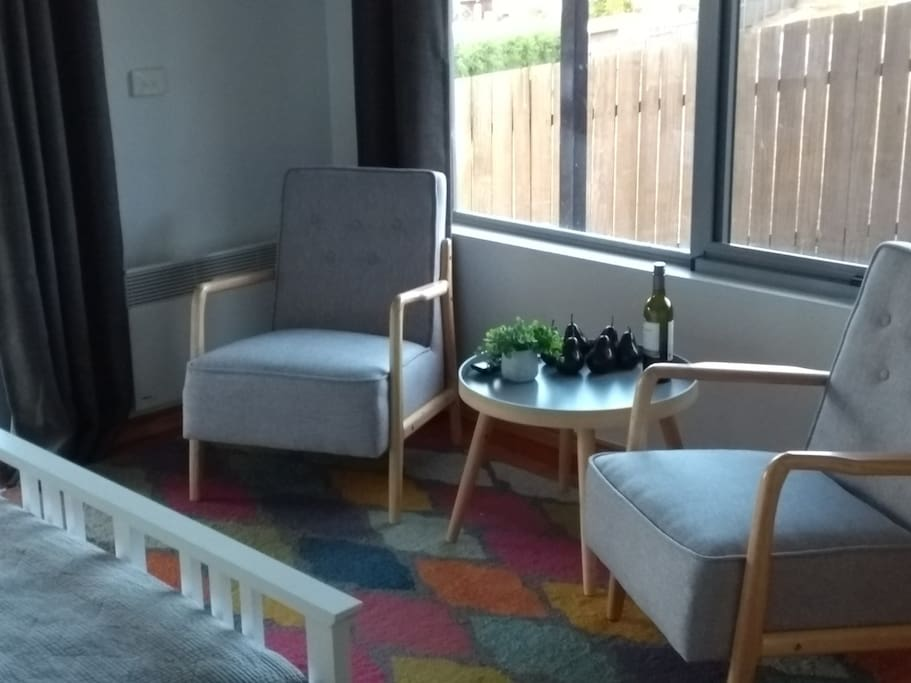Guest seating in bedroom ( chairs moved outside if trundle required )