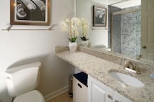 Take some time to enjoy the thoughtful details that pull this new bathroom together.