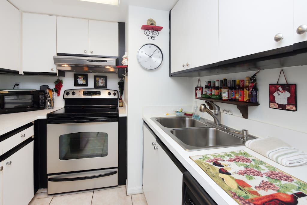 electric stove, microwave, toaster, fridge with ice maker