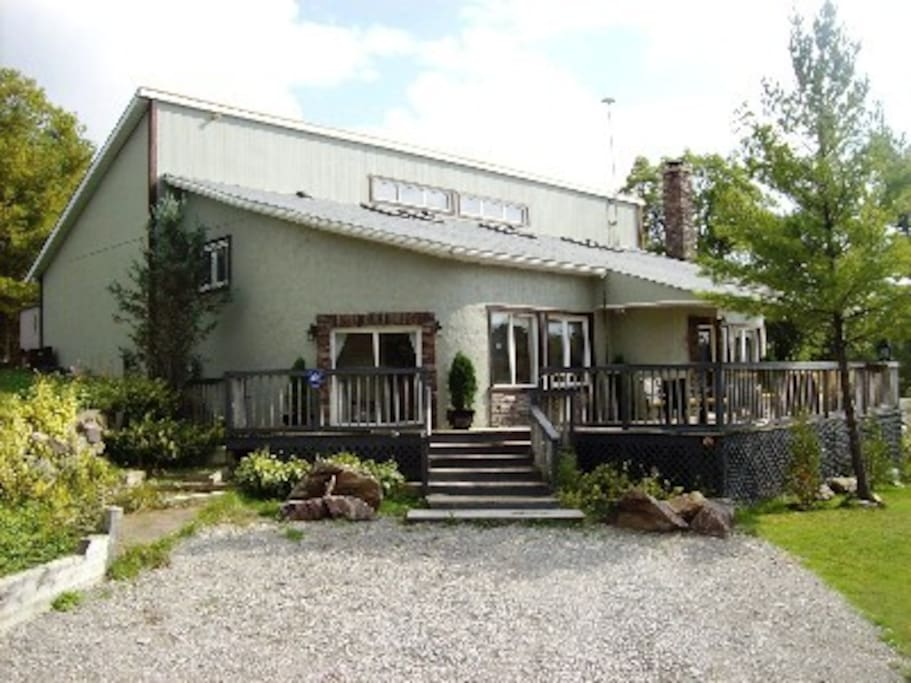 Features 19 Foot Vaulted Ceilings, Massive Stone Fireplace, Bunkie, Sleeps 12.