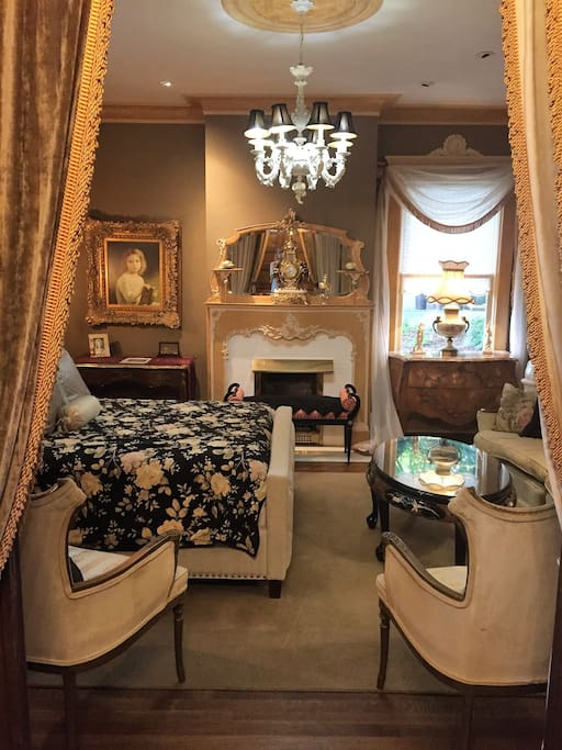 It has a working gas fireplace, massive pocket doors, and 10' high ceilings all faux marble trim and mantle. The Capa De'Monte chandelier graces over a queen size bed lavished with high quality linens in down and Egyptian cotton.