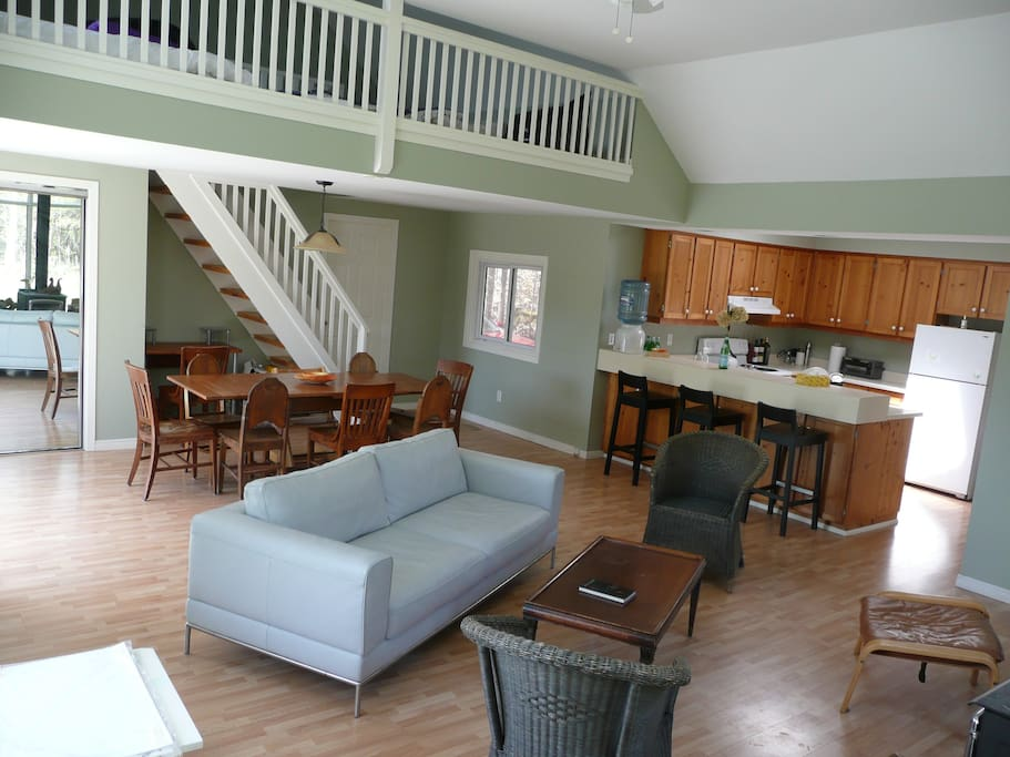 Large dining table and fully stocked kitchen. Open sleeping loft for 3 is up the stairs. Separate bedroom is of to the side.