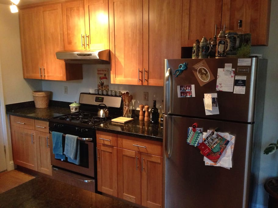Recently renovated kitchen with granite countertops, gas stove, stainless steel appliances.