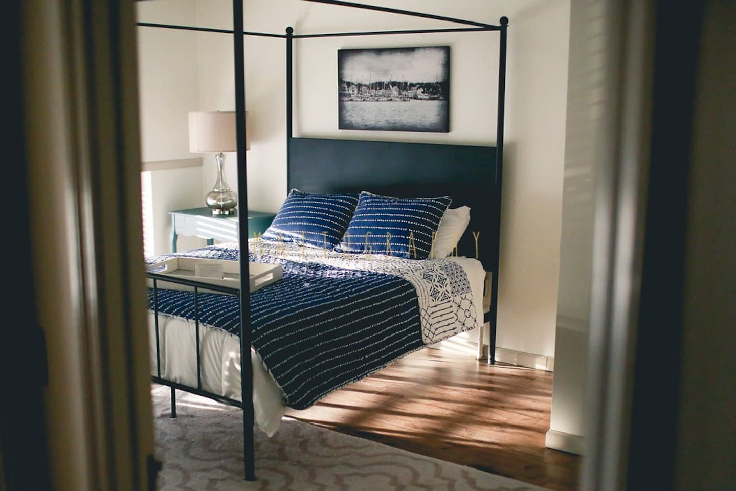 Master bedroom. Queen canopy bed with luxurious pillow top mattress.
