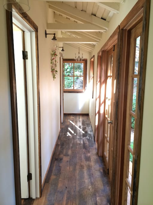 This bright hallway feels spacious as you make your way from the bedroom to bathroom.