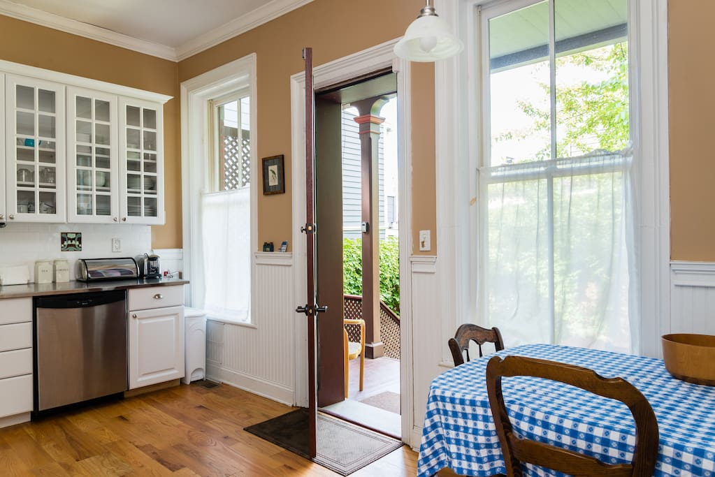 Newly renovated fully equipped kitchen with door leading to back porch and garden.
